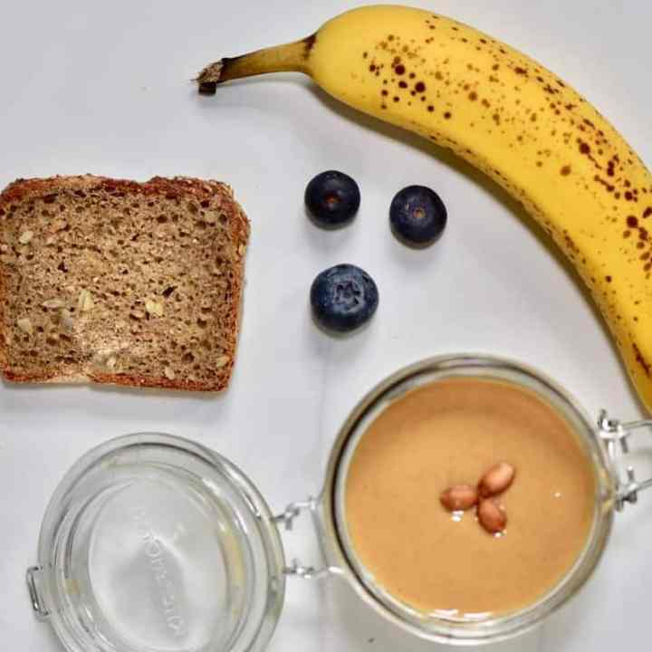healthy toast recipe with homemade almond butter, banana and blueberries