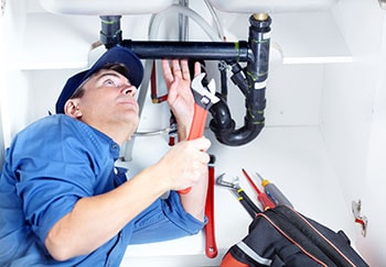 Professional Plumber Doing Sink Reparation