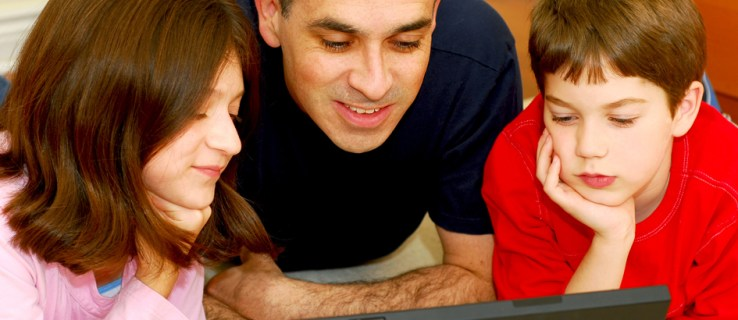 Kids with parents on laptop