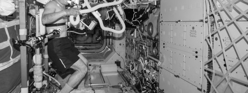 pedalling-to-mars-balck-and-white-shot-of-astronaut-on-cevis