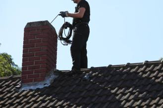 Offering Huntington, NY Sweep Services - Westchester Co NY - Alpine Chimney Sweeps