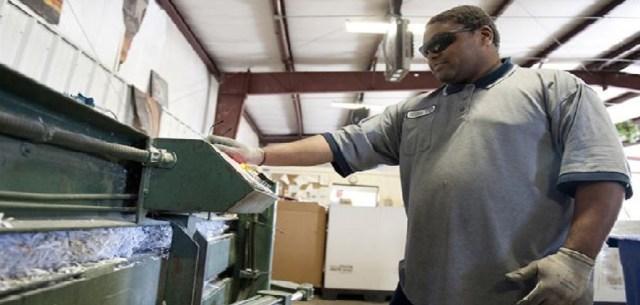 man using shredding machine