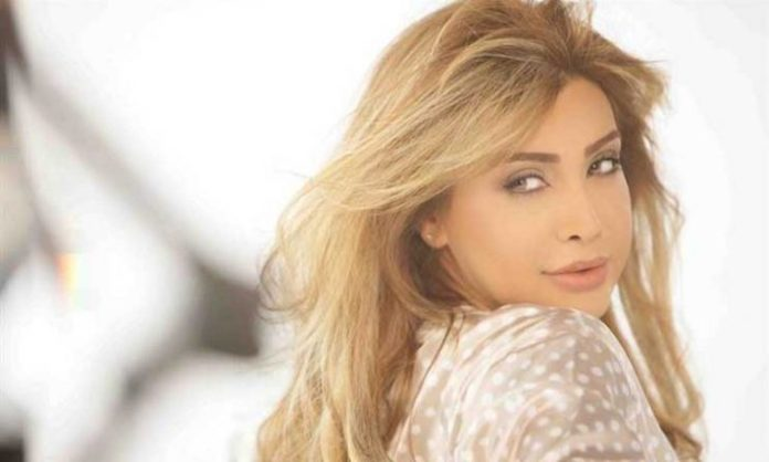 How did Nawal Al-Zoghbi respond to a Kuwaiti media person who threatened her with spreading a rumor about her?
