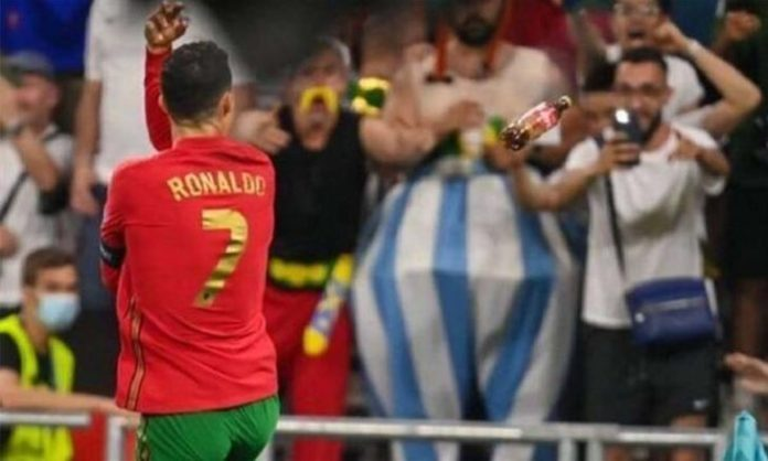 Fans throw Coca-Cola bottles at Ronaldo during the Portugal-France match