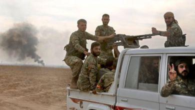 مسلحون سوريون يقاتلون في بلادهم إلى جانب القوات التركية
