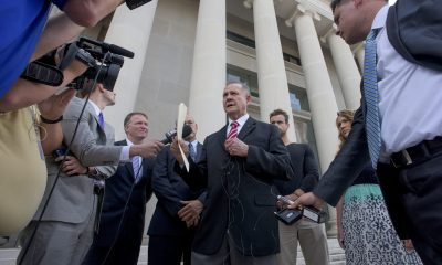Roy Moore speaks to reporters and supporters