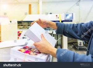 stock-photo-manipulating-envelopes-for-mailing-601007444