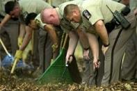 Police search the sniper crime scene near the middle school