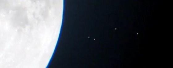 Four UFOs approaching the Moon