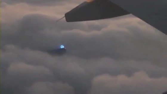 Glowing blue UFO flimed from commercial airliner