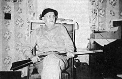 Fred Beck years after the attack - holding the gun used in the Ape Canyon attack