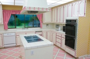 Pink trim decorate this 70's era kitchen