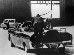 Seconds after the shots, Secret Service agent Clint Hill has jumped onto the back bumper of the limousine