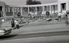 Mourners leave flowers at Dealey Plaza after the assassination (shot on November 24, 1963)