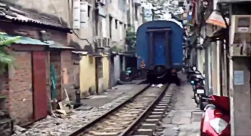Hanoi, Vietnam: Crazy train passes inches from residents' front doors