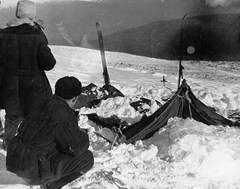 Search and rescue examine a Dylatov Pass tent