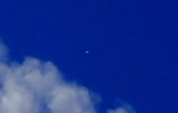 White and silver orbs photographed around a chemtrail