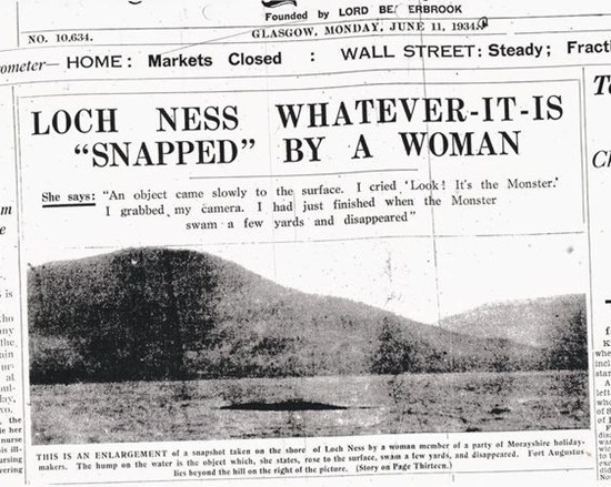1934 newspaper headline: Loch Ness Whatever-it-is snapped by a woman