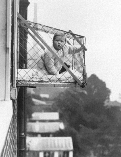 Baby cages were used to ensure that children received fresh air and sunlight despite living in high-rise apartment buildings – 1937.