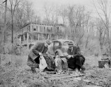 Investigators pour over evidence found near the deserted Westchester home where Albert Fish murdered Grace Budd