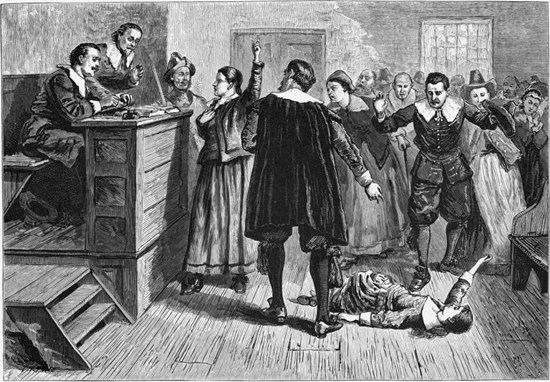 Accused witch rolls around on the floor during the Salem Witch Trials