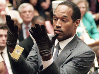 """If they don't fit, you must acquit"" - OJ demonstrates that the gloves found on the scene do not fit him"