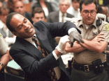 OJ demonstrates that the gloves found on the scene do not fit him