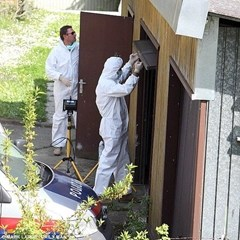 Investigators looking inside the garage of the Josef Fritzl house