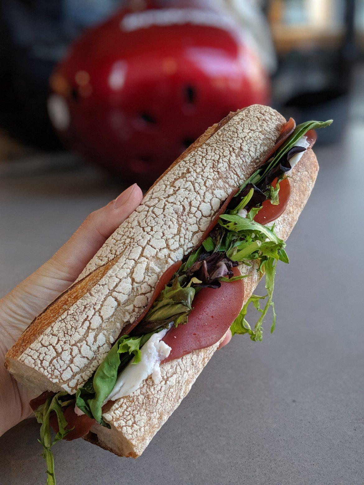 a vegan prosciutto and mozzarella sandwich from Riverdel at Essex Market, New York
