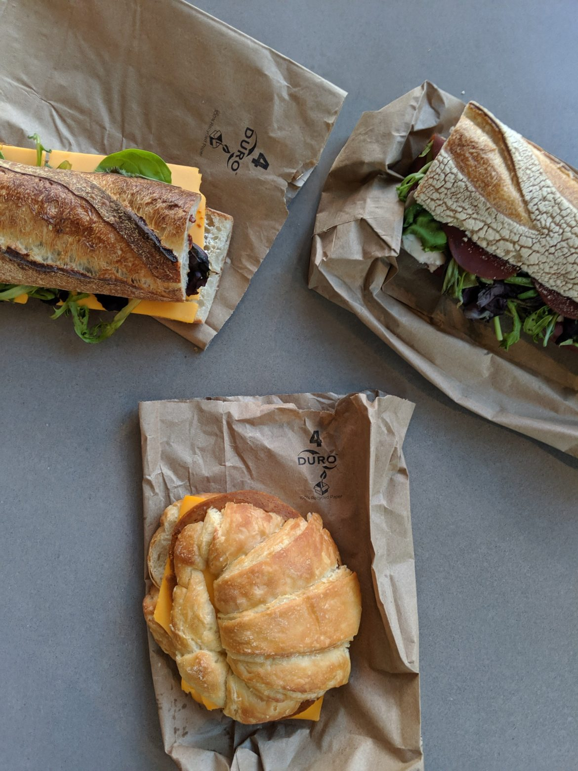 three sandwiches from Riverdel at Essex Market, New York
