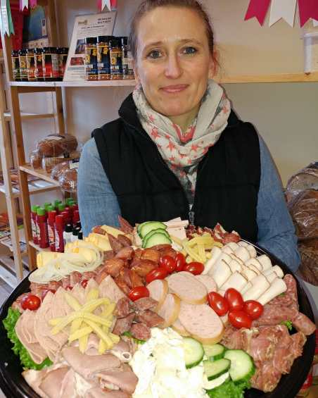 Sandra showing mixed tray she made for a customer's special event