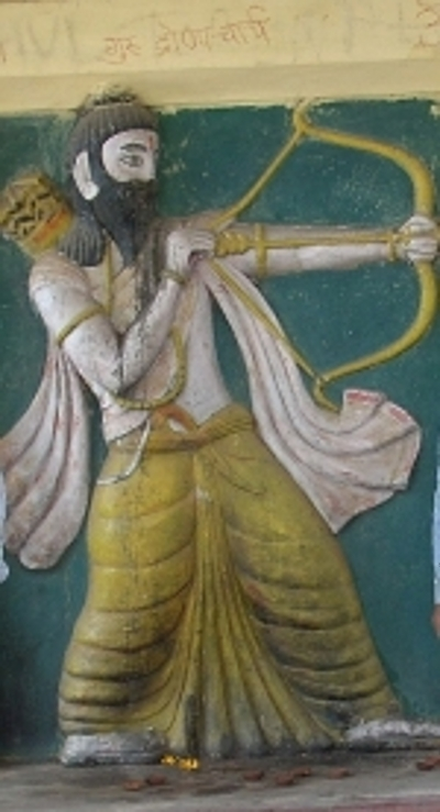 At the top of the mural, you'll find 'Guru Dronacharya' written in light letters