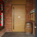 Huge Swing Door with Wood Panels