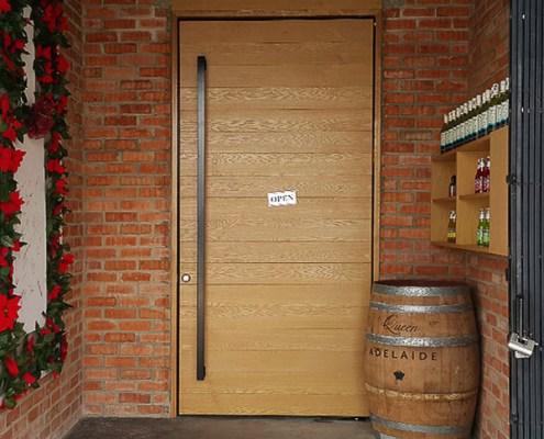 Huge Swing Door with Wood Panels