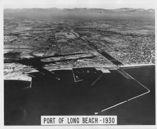 1930 - An aerial view of the Port. Oil derricks dot the skyline in the background. Courtesy of the Port of Long Beach