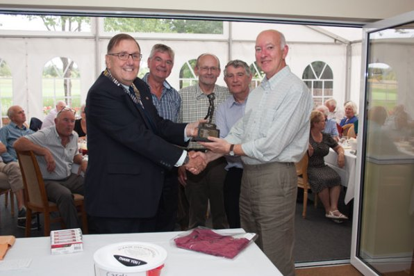 The winning team, 4ForTee, Peter Beagles, Brian Beckett, Mick Pye and Dave Harmon, being presented with their trophy by Alton Lions President Peter Bacon