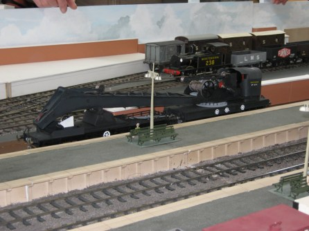 A travelling crane waiting at a platform on Nomandy Junction