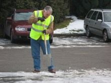 AMRG member Roger Joel tries to clear the snow and ice in the car park