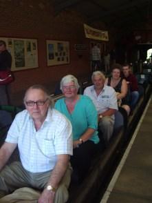 Members board the train