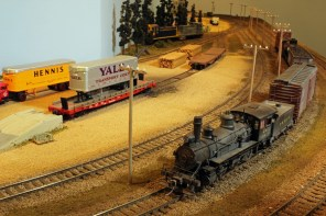 A local steamer brings a new freight train into the yard