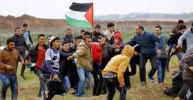 شهيد ومئات الاصابات برصاص الاحتلال وسحب أجزاء من السياج الشائك شرق خانيونس