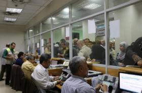 المالية: غداً بدء صرف دفعة من رواتب الموظفين بغزة