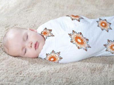 القماط يساعد طفلك المولود حديثا على النوم