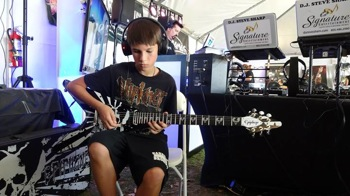 Fan playing a guitar at the Crazy Dave's Music Experience
