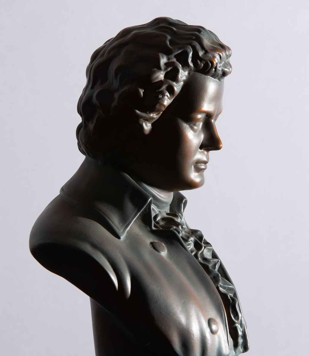 a a bronze statue of ludwig van beethoven