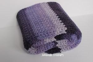 free crochet blanket pattern featuring caron cake yarn
