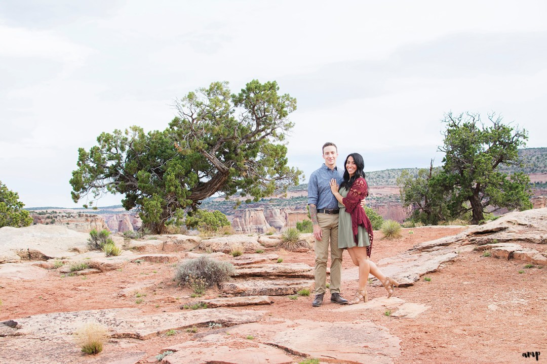 Couple standing in the desert of the Colorado National Monument