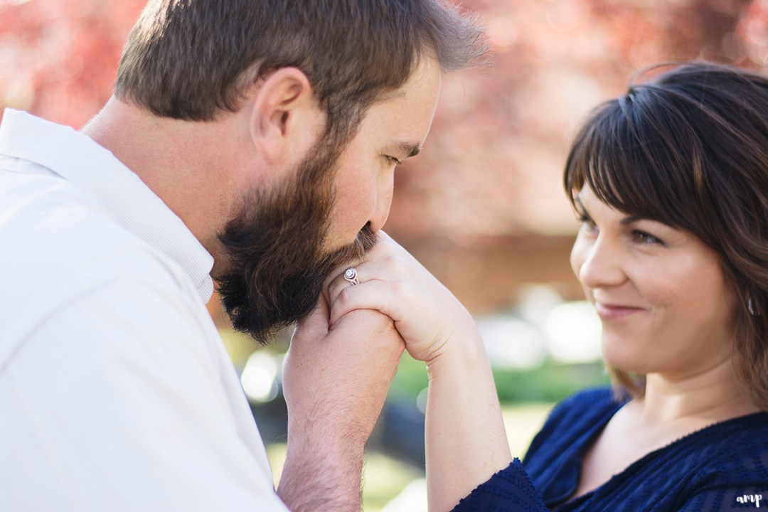 Man kissing fiance's hand, ring shot