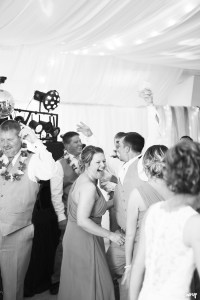bridesmaid laughing on the dance floor