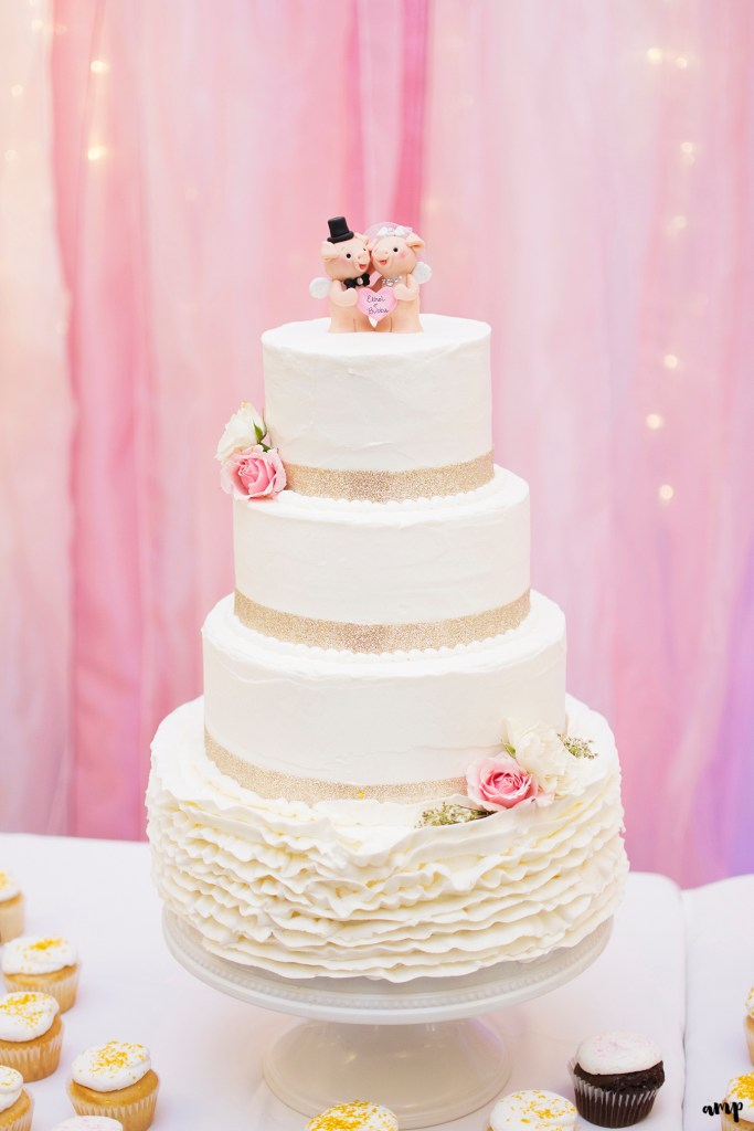 Wedding cake with pigs cake topper